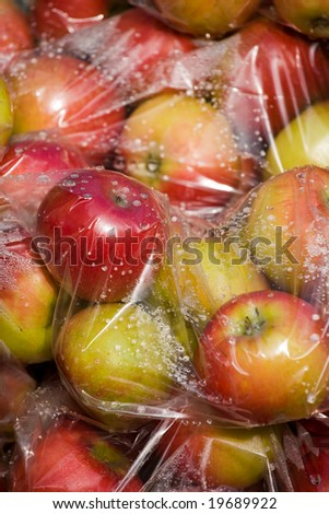 Apples in a plastic bags - stock photo