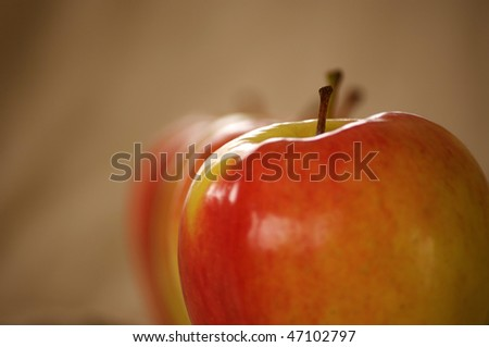apples in a row, shallow depth of field - stock photo