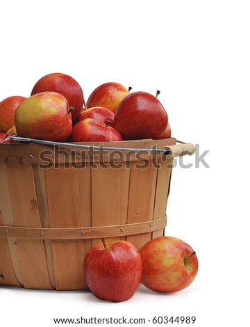 Apples in a wooden basket on white