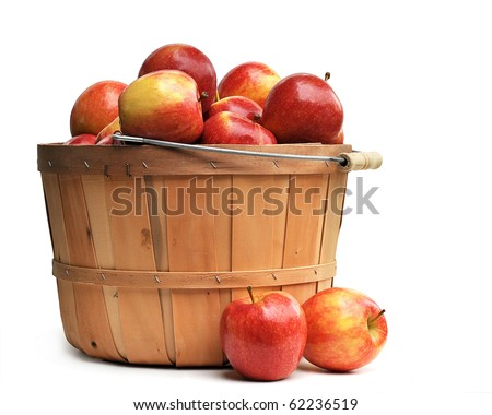 Apples in a wooden basket on white - stock photo