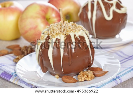 Apples in chocolate with nuts