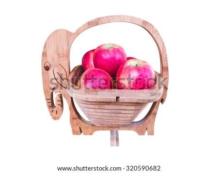 apples in wood basket - stock photo
