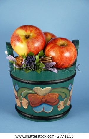 Apples in wooden bucket painted in Norwegian Rosemaling style.