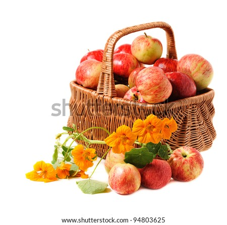 apples in woven basket on white background