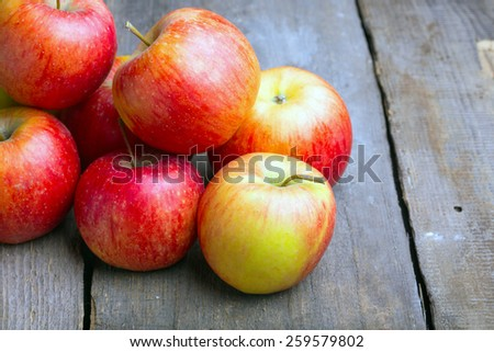 apples on a wooden table - stock photo