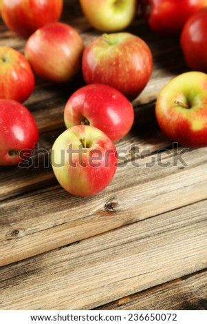 Apples on brown wooden background - stock photo