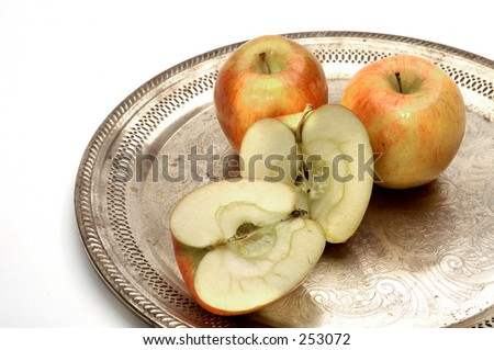 Apples On Silver Platter photographed on white. - stock photo