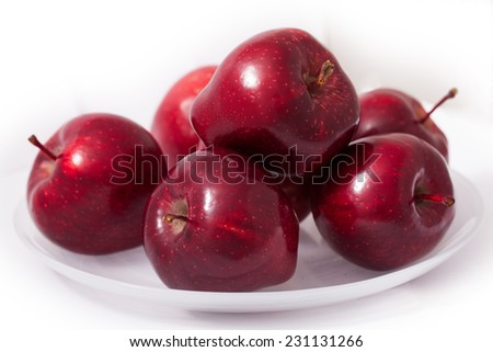 Apples on the plate - stock photo