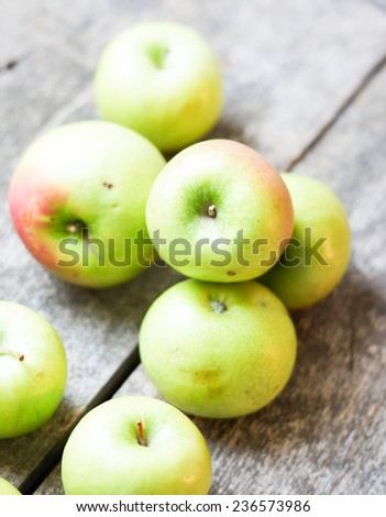 Apples on wooden background - processing still life effect style  - stock photo
