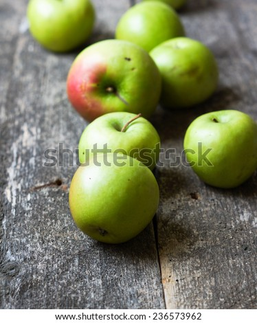 Apples on wooden background - processing still life effect style pictures - stock photo