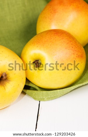 Apples on wooden table - stock photo