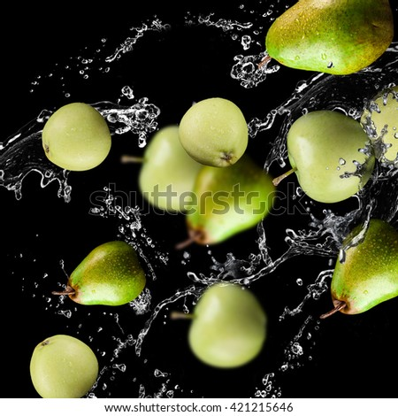 apples, pears fruits and Splashing water - stock photo