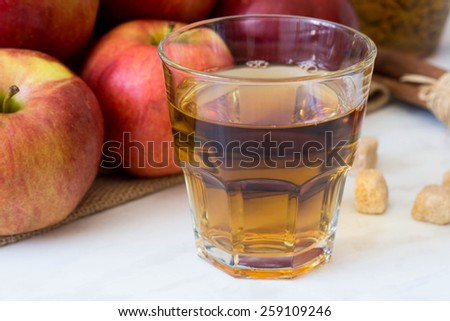 Apples  with juice on the wooden background - stock photo