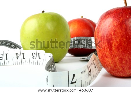 apples with measuring tape - stock photo