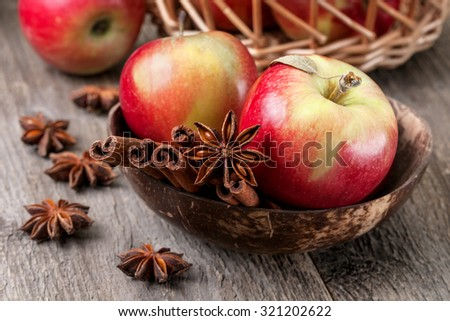Apples with spices: cinnamon, star anise on a wooden background
