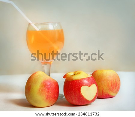 apples with wine glass of apple juice still life  - stock photo
