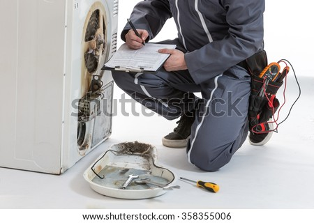 Appliances Repairman  - stock photo