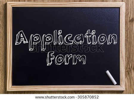 Application Form - New chalkboard with outlined text - on wood - stock photo