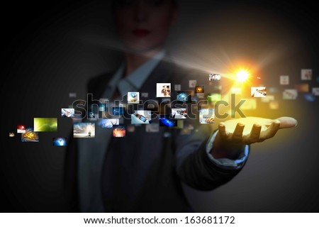 Application icons in human hand. Wireless technologies - stock photo