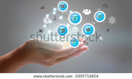 Application icons interface on hand. Social media concept
