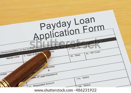 Applying for a Payday Loan, Payday loan application form with a pen on a desk