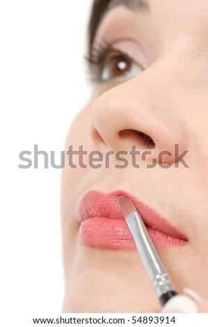 applying liquid glossy lipstick - stock photo
