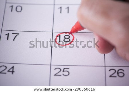 Appointed day on the calendar with pen - stock photo
