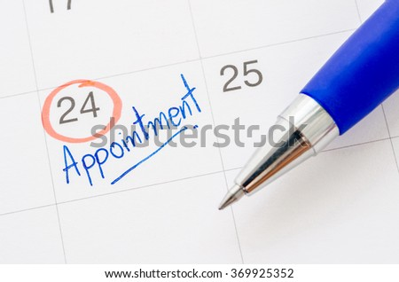 Appointment written with pen on calendar to remind you an important appointment. - stock photo