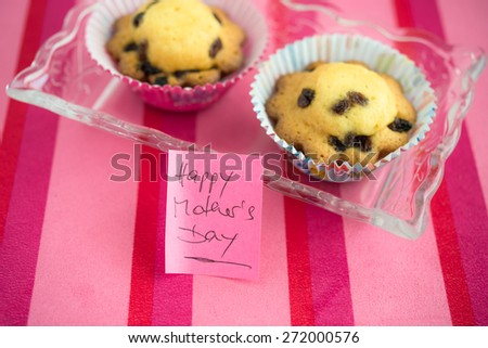Appreciation to Happy Mother's Day with cupcake and text message  Happy Mothers Day greeting card with love you mom sticky note on pink striped background - stock photo
