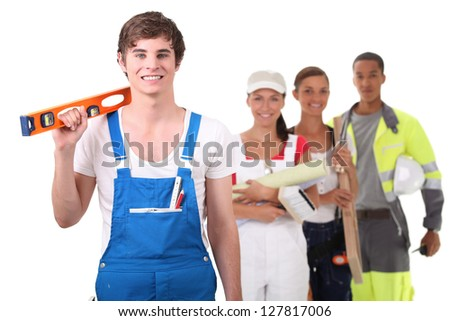 apprentice craftsman holding a level - stock photo