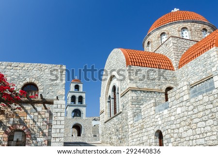 Approach to Orthodox temple of Agios Savvas on Greek Kalymnos island view from lower angle - stock photo