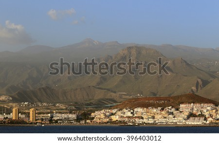 Approaching Los Cristianos in the evening with Mount Teide towering above, Tenerife, Canary Islands, Spain.
