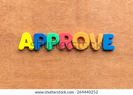 approve colorful word on the wooden background - stock photo