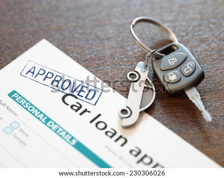 Approved car loan application with car keys - stock photo