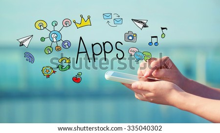 Apps concept with person holding a smartphone  - stock photo