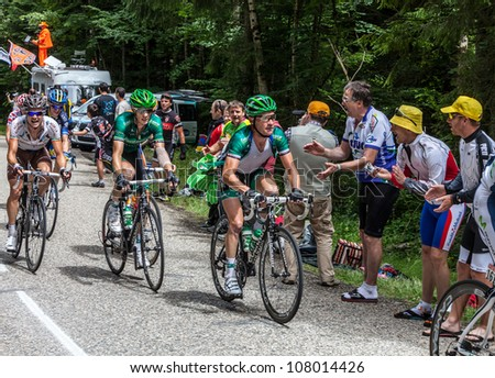 APREMONT,FRANCE,JUL 13: Cyclists(on right-Thomas Voeckler-Team Europcar) climbing the last kilometer on the road to mountain pass Granier in the stage 12 of Le Tour de France on July 13 2012. - stock photo