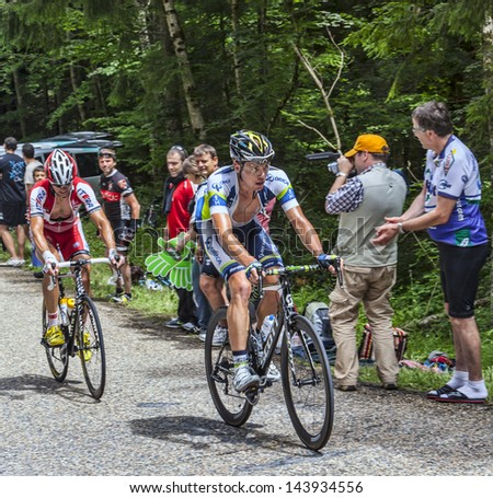 APREMONT,FRANCE-JULY 13 : Unidentified cyclists climbing the last kilometers of the road to Col du Granier in the Alps during the stage 12 of Le Tour de France in Apremont on 13 July 2012. - stock photo
