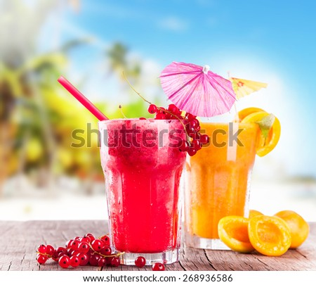Apricot and currant cocktails on wooden table with beach background, summer concept, fresh fruits - stock photo