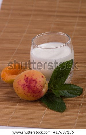 apricot and milk in bowl isolated on white background - stock photo