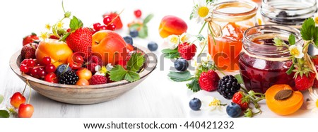 Apricot, blackberry, strawberry jam, fresh berries and fruits on white background - stock photo