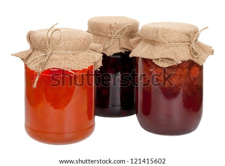 Apricot, cherry and strawberry jam - stock photo