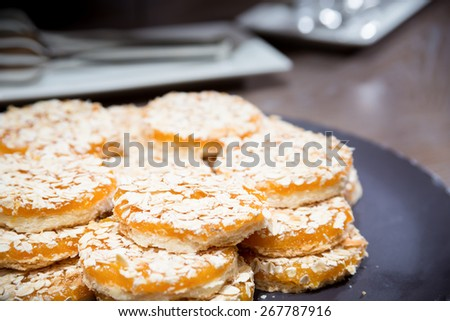 Apricot cookies on wooden table. Shallow DOF and lightly toned. - stock photo