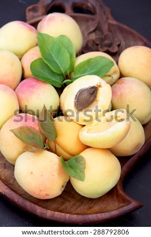 Apricot. Ripe apricots on a wooden tray