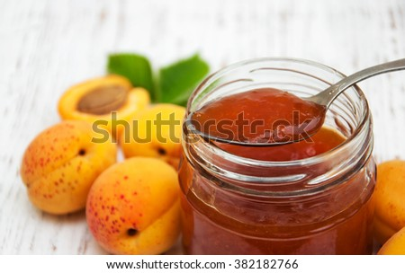 Apricots jam on a old wooden background