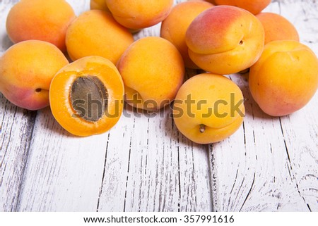 apricots on a  wood background - stock photo
