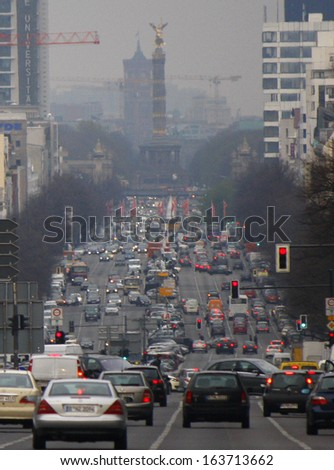"APRIL 2012 - BERLIN: traffic during rush hour on the Heerstrasse in the Charlottenburg district of Berlin, in the background the ""Siegessaeule"" (Victory Column) and Rote Rathaus (CityHall)."