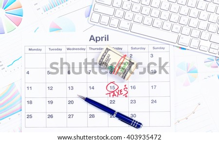 April. Business calendar and documents. April 15 last day of filing tax returns. Desktop Manager. Planning. Flat lay. Office desk with business calendar, keyboard, money, eyeglasses, top view
