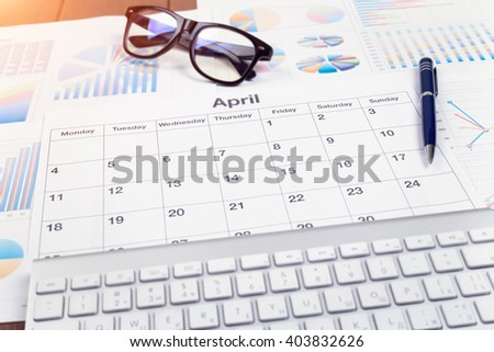 April - Business calendar, Planning. Desktop Manager. View from above.  - stock photo