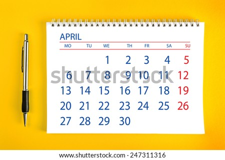 April Paper Calendar Page with Spiral Binding as Time Management and Schedule Concept, top view - stock photo
