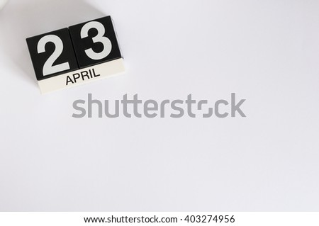 April 23rd. World Book Day. Image of april 23 wooden color calendar on white background.  Spring day, empty space for text - stock photo